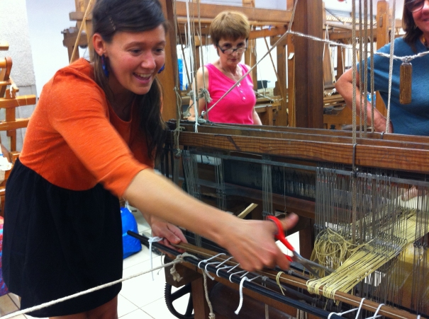 Amy Ilic eagerly removes her first ikat weaving
