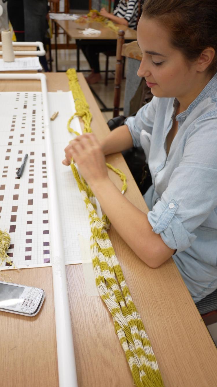 Dominika Zietek removes the last bindings from her warp
