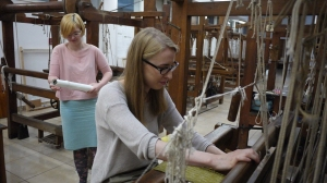 Working as a team, Katarzyna Sojka weaves up the warp that Dominika Zientek designed the previous week. The looms she is weaving on was once in one of the many weavings mills that populated the city.