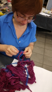 Liliana Chwistek removes binding from her warp, dyed with Brazilwood.