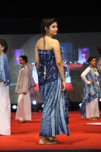 Combining multiple forms of stitch resist, Dr. Reena Bhatia created a garment in shade of indigo blue that shift as the model turns.