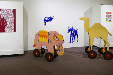 Elephant and camel, painted wood
